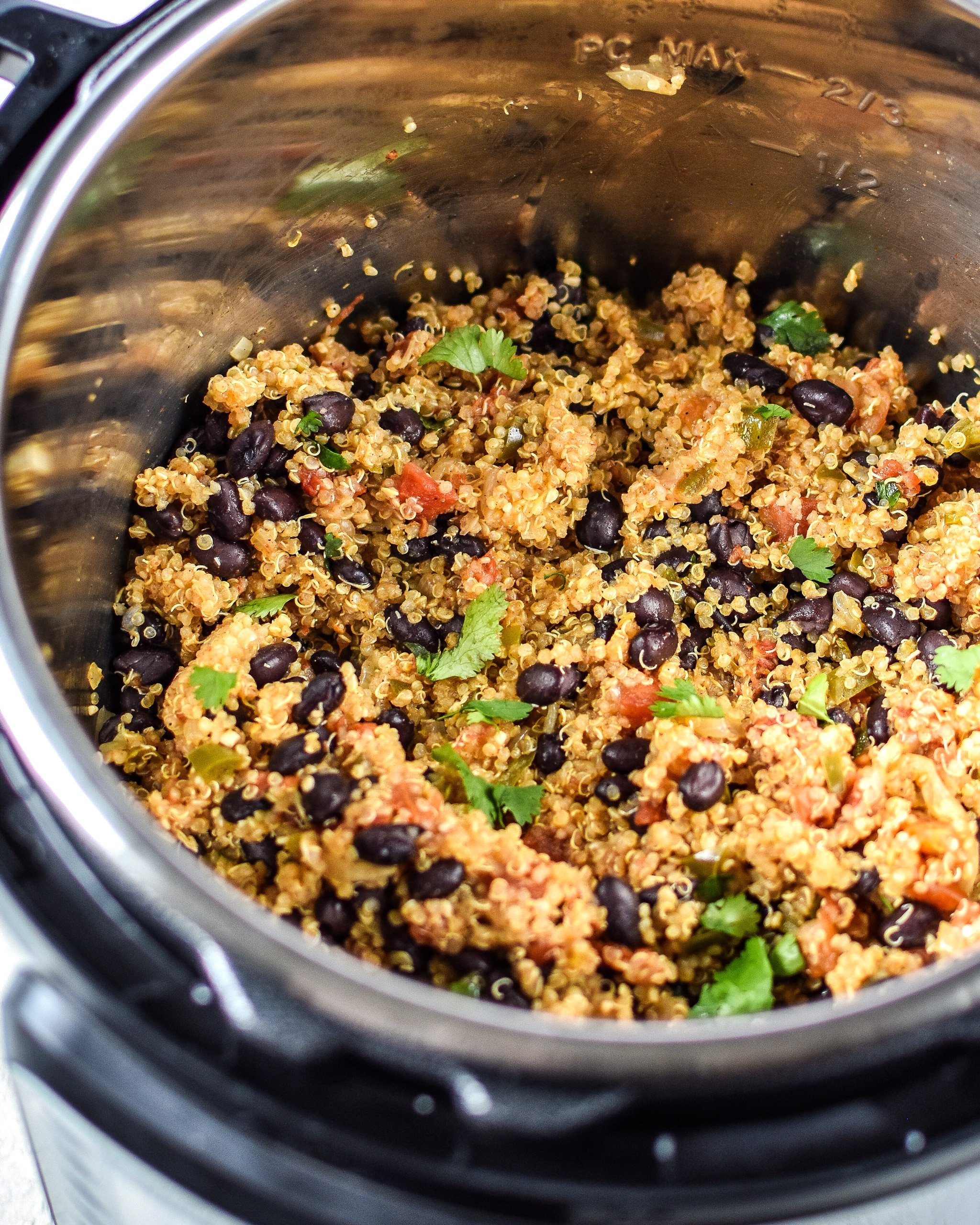 Cooked Mexican quinoa with black beans and cilantro in an Instant Pot.
