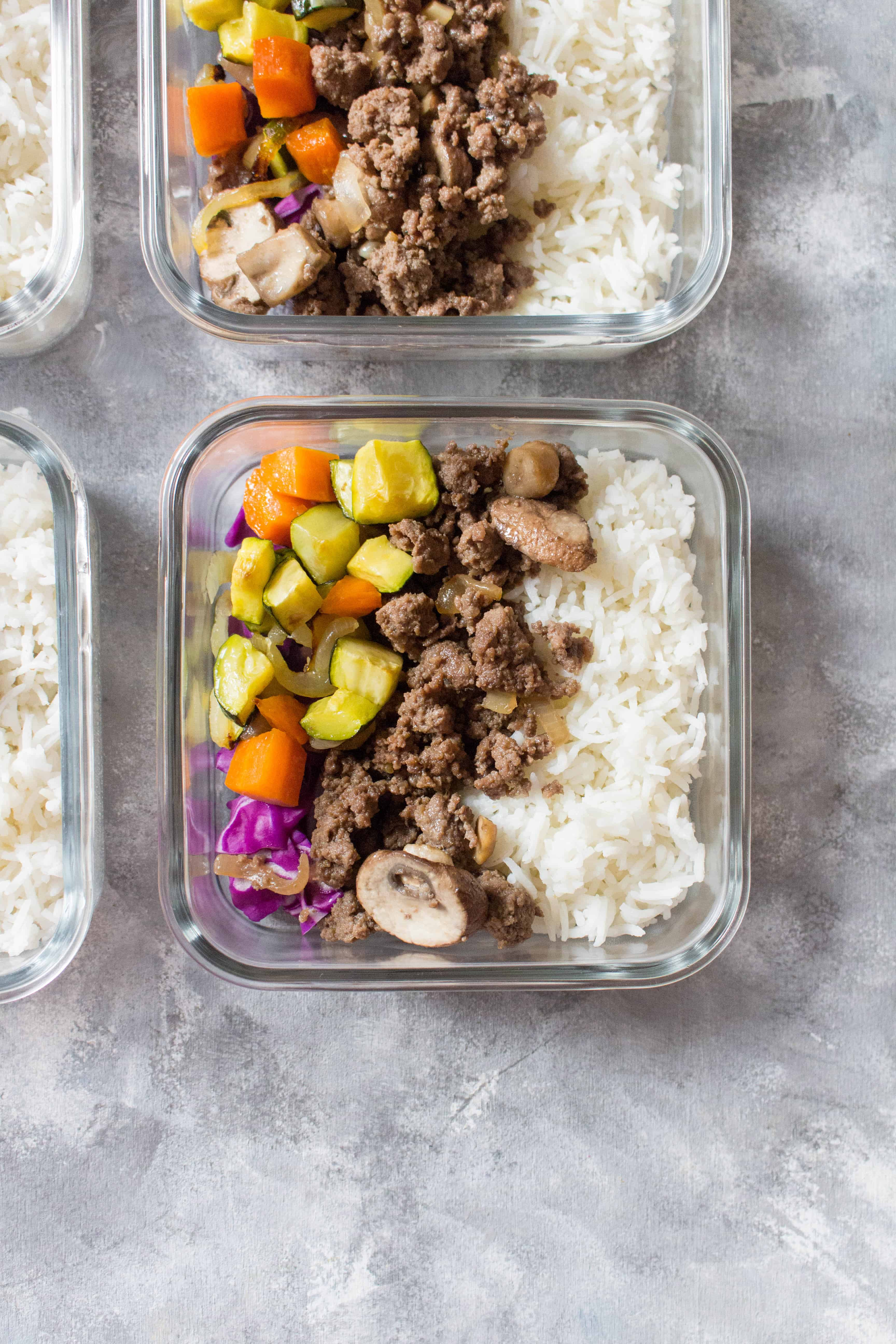 Korean beef bowls with rice and veggies portioned into meal prep containers for lunch. Meal Prep Lunch Recipes