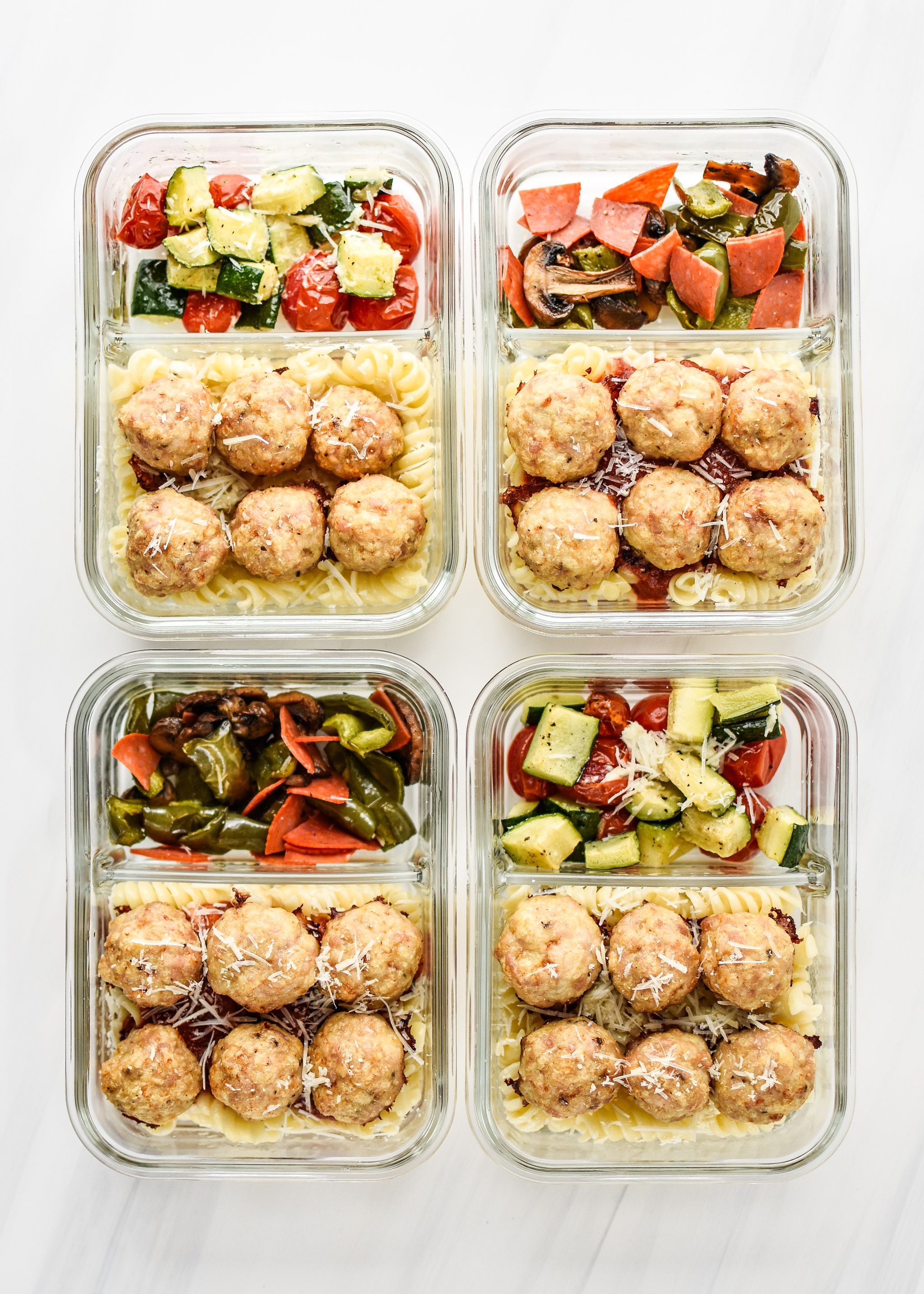 Chicken Meatballs recipe two ways portioned into lunch meal prep containers.