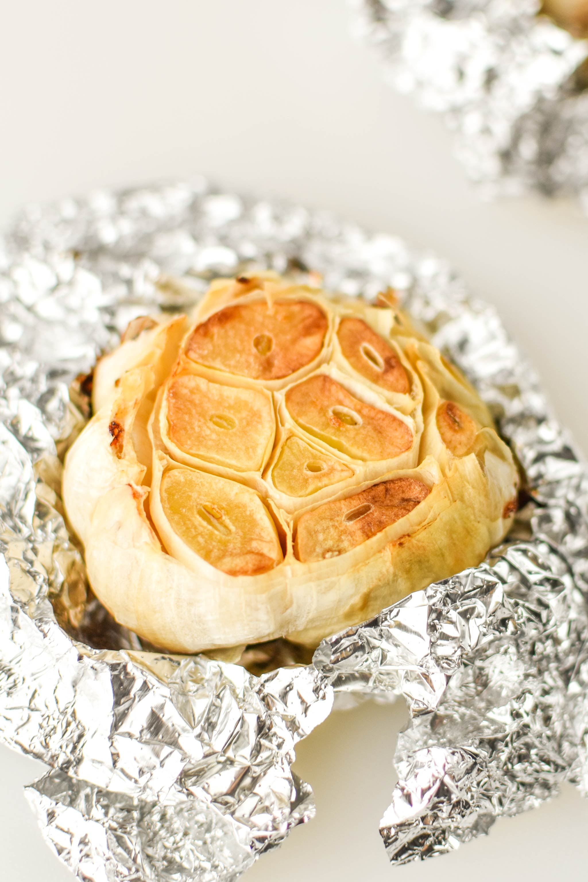A head of garlic freshly roasted in the air fryer.