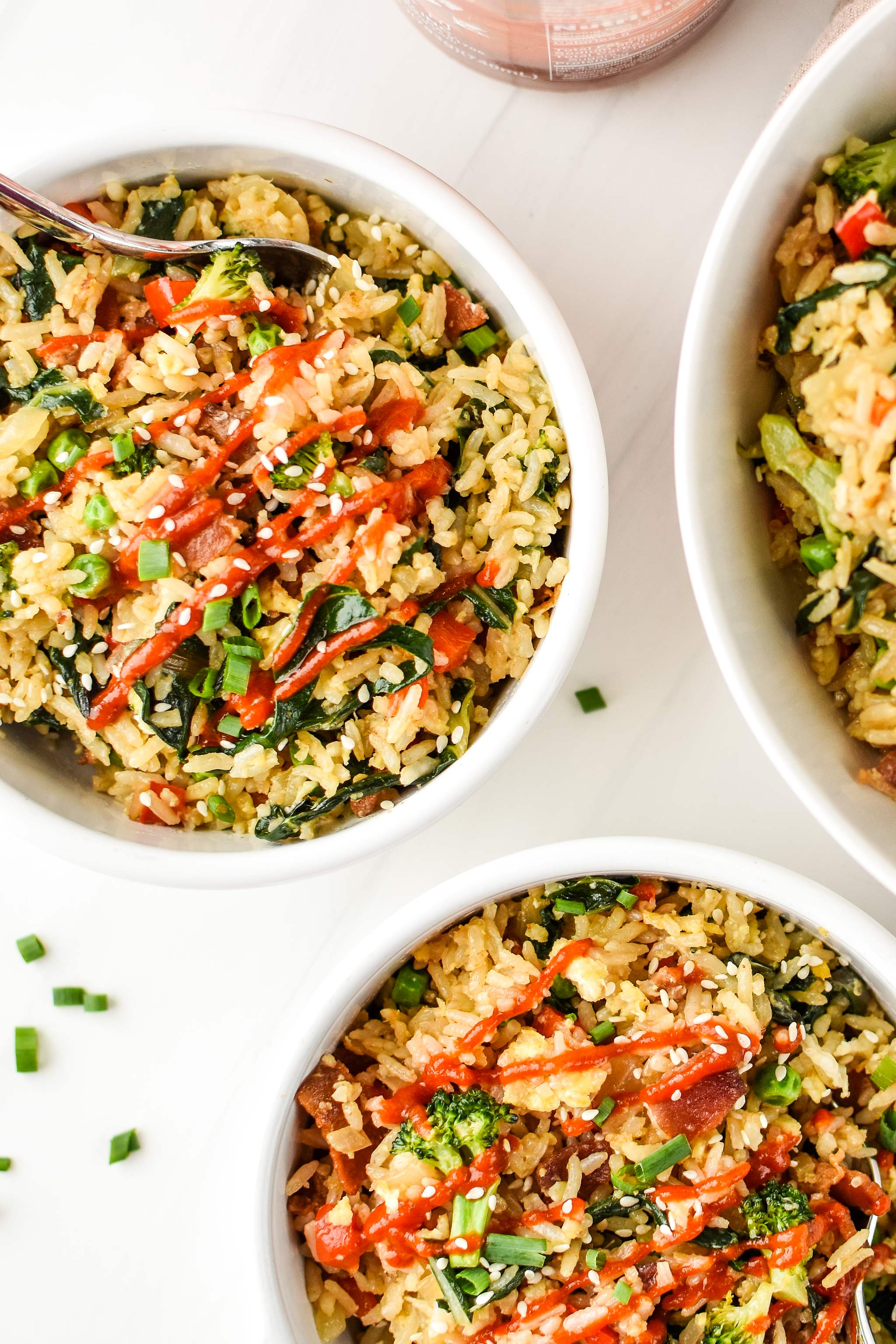 Bowls of veggie packed breakfast fried rice seen from above